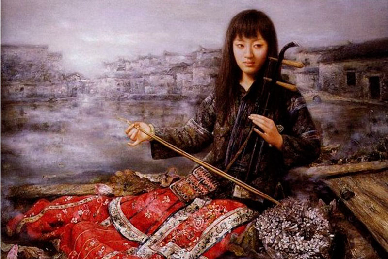 Девушка якутка играет на кырыымпе